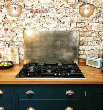 small brass splashback mottled finish kitchen
