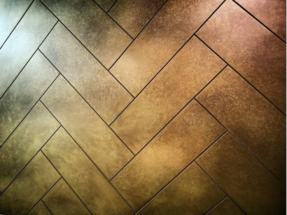 Brass parquet brick tile kitchen splashback