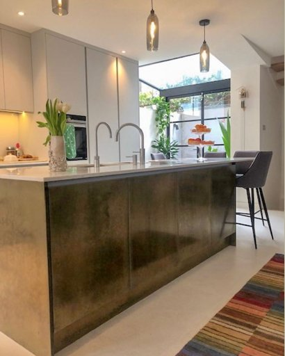 kitchen island with brass panels and doors london
