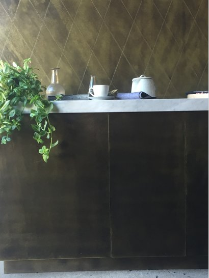 brass kitchen door splash