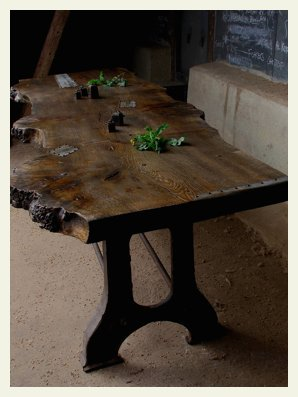 oak slab table top on a cast iron base