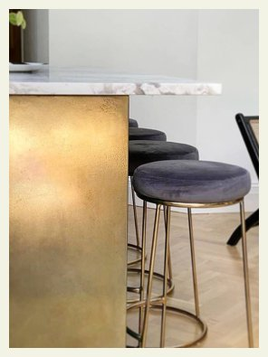 Gently aged brass kitchen island