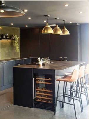 kitchen brass triangular tile splashback